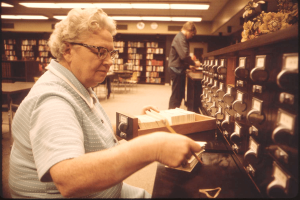 Librarian at card catalog